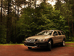 2004 Volvo XC70 car in the countryside nature scenic with forest trees in the background. Muskoka, Ontario, Canada. Image © MaximImages, License at https://www.maximimages.com