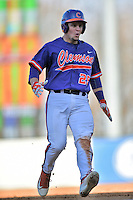 Clemson Tigers catcher Chris Okey (25) runs into third on a triple during a game against the South Carolina Gamecocks at Fluor Field on March 5, 2016 in Greenville, South Carolina. The Tigers defeated the Gamecocks 5-0. (Tony Farlow/Four Seam Images)