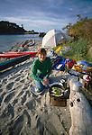 Sea kayak camping, Sucia Island, San Juan Islands, Puget Sound, Salish Sea, Washington State, Pacific Northwest, USA, North America, woman camp cooking, beach camp site, modelreleased, Sarah Shannon, .