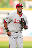 Victor Roache (28) of the Wisconsin Timber Rattlers jogs off the field between innings of the Midwest League game against the Great Lakes Loons at the Dow Diamond on May 4, 2013 in Midland, Michigan.  The Timber Rattlers defeated the Loons 6-4.  (Brian Westerholt/Four Seam Images)