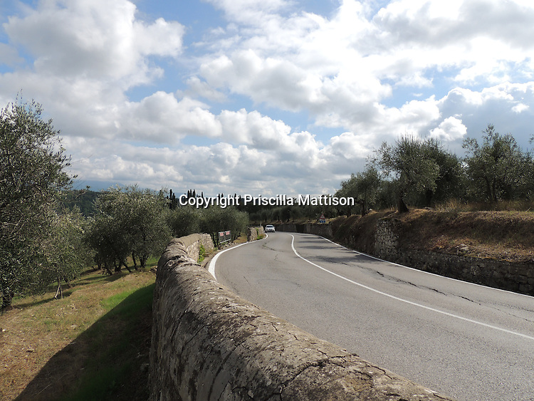 San Donato in Collina, Italy - October 2, 2012:  A curving roadside wall in Tuscany.