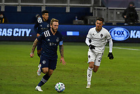 KANSAS CITY, KS - OCTOBER 24: #7 Johnny Russell of Sporting KC drives the ball upfield as #26 Cole Bassett of the Colorado Rapids tries to catch up during a game between Colorado Rapids and Sporting Kansas City at Children's Mercy Park on October 24, 2020 in Kansas City, Kansas.