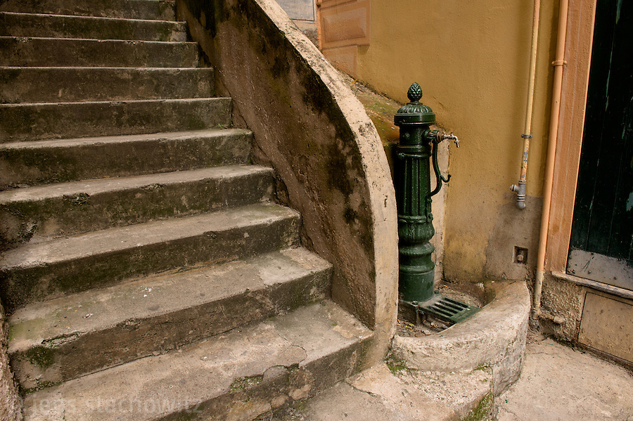 An ancient standpipe next to the stairs in downtown Camogli leading up the hill.