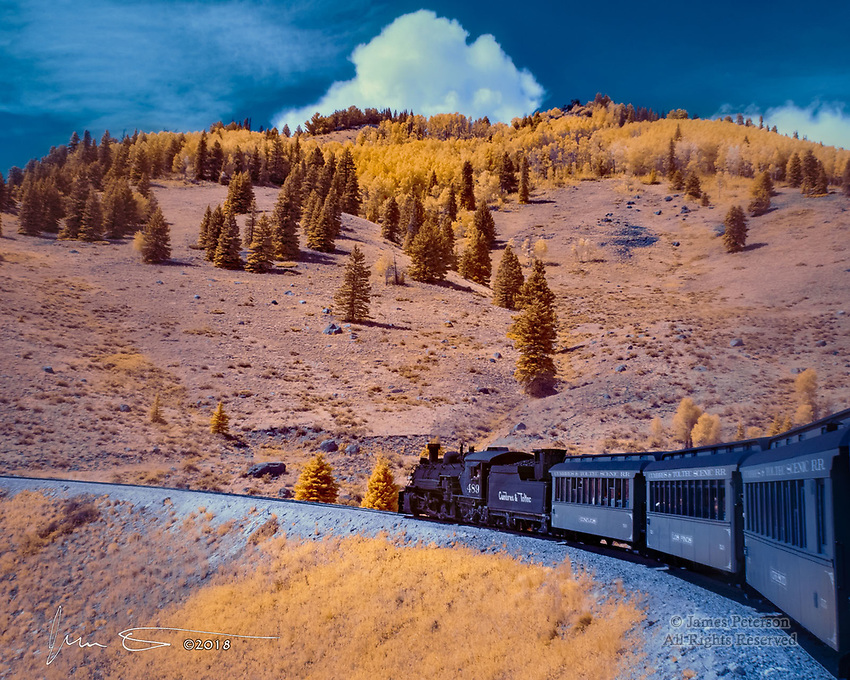 Heading for The Pass (Infrared) ©2018 James D Peterson.  On a late summer afternoon, Engine 489 hauls its passengers through the southern San Juan Mountains on its way from Antonito, Colorado to Chama, New Mexico.  This excursion was accompanied by some late summer monsoon activity along the route of the historic Cumbres and Toltec Scenic Railroad, formerly part of the Denver and Rio Grande Western Railroad.