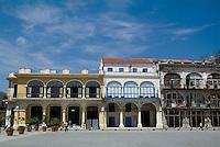 People walking near Taberna de la Muralla on Plaza Vieja in Havana, Cuba.