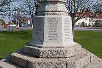 Names of the local men and women who were killed in two world wars.  War memorial, Giggs Hill Green, Thames Ditton, Surrey.