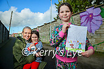Katie Laide who wrote a letter to Kerry's Eye about dog poo in Tralee pictured here with her sister Katie and mom Deirdre.