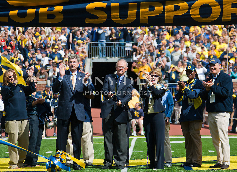 From center left to right, Michigan Athletic Director David Brandon, former Athletic Director Bill Martin, and University President Mary Sue Coleman, officially re-dedicate Michigan stadium with members of the Board of Regents, before an NCAA college football game, Saturday, Sept. 4, 2010, in Ann Arbor, Mich. After a three year, $226 Million renovation, the Big House is now bigger than ever, reclaiming the country's title as largest college football stadium in capacity. (AP Photo/Tony Ding)