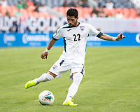 DENVER, CO - JUNE 19: Roberney Caballero #22 shoots on goal during a game between Martinique and Cuba at Broncos Stadium on June 19, 2019 in Denver, Colorado.