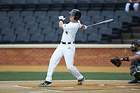 DJ Poteet (4) of the Wake Forest Demon Deacons follows through on his swing against the Davidson Wildcats at David F. Couch Ballpark on May 7, 2019 in  Winston-Salem, North Carolina. The Demon Deacons defeated the Wildcats 11-8. (Brian Westerholt/Four Seam Images)