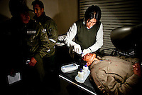 .Doctor and police officers with injured victim in a medical center.Just 25 years ago it was a small group of houses around La Paz  airport, at an altitude of 12,000 feet. Now El Alto city  has  nearly one million people, surpassing even the capital of Bolivia, and it is the city of Latin America that grew faster .<br /> It is also a paradigmatic city of the tubles and traumas of the country. There got refugee thousands of miners that lost  their jobs in 90 ´s after the privatization and closure of many mines. The peasants expelled by the lack of land or low prices for their production. Also many who did not want to live in regions where coca  growers and the Army  faced with violence.<br /> In short, anyone who did not have anything at all and was looking for a place to survive ended up in El Alto.<br /> Today is an amazing city. Not only for its size. Also by showing how its inhabitants,the poorest of the poor in one of the poorest countries in Latin America, managed to get into society, to get some economic development, to replace their firs  cardboard houses with  new ones made with bricks ,  to trace its streets,  to raise their clubs, churches and schools for their children.
