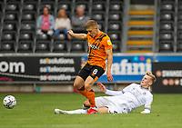 11th September 2021; Swansea.com Stadium, Swansea, Wales; EFL Championship football, Swansea versus Hull City; Greg Docherty of Hull City is tackled by Flynn Downes of Swansea City
