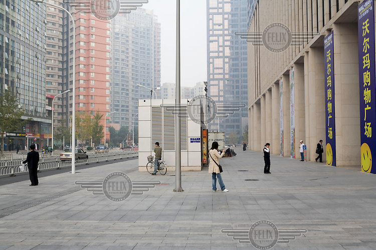 Office blocks and private residential estates in the centre of town. Property prices have risen dramatically in the past few years making it difficult for ordinary Chinese to afford an apartment in Beijing.