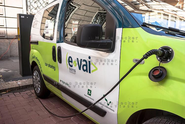"""Milano, car sharing e-vai. Una vettura elettrica in carica presso una colonnina di ricarica a2a --- Milan, """"e vai"""" car sharing. An electric vehicle at a charging column"""