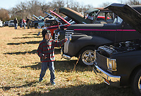 Maverick Cross, 6, of Highfill reacts as he looks at cars, Sunday, November 15, 2020 during a car show at the Holland Barn in Highfill. Michael Ratledge and Shane Hargrave founders of Gravette Cruise and Quarantine organized a car show fundraiser to raise money for the Arkansas children's shelter. One hundred percent of proceeds will go to the shelter said Ratledge. Check out nwaonline.com/201116Daily/ for today's photo gallery. <br /> (NWA Democrat-Gazette/Charlie Kaijo)