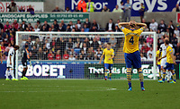 Saturday 28 September 2013<br /> Pictured: Per Mertesacker of Arsenal (R) holds his head in his hands after a missed opportunity by a team mate of his<br /> Re: Barclay's Premier League, Swansea City FC v Arsenal at the Liberty Stadium, south Wales.