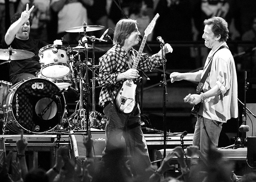 """Jackson Browne (center) is surprised by  Bruce Springsteen onstage at the """"Vote for Change"""" concert series at Continental Airlines Arena.   EAST RUTHERFORD, NJ  10/13/04  10:02:34  ANDREW MILLS/THE STAR-LEDGER..Taken at F 2.8, shutter 1/400, ISO 800.white balance Auto  sharpening .Canon EOS-1D Mark II 214658"""