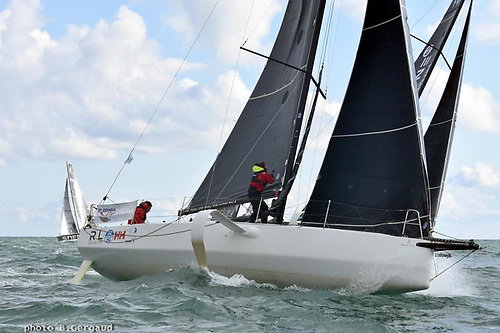 Kenneth Rumball and Pamela Lee onboard their Figaro 3 foiler in France