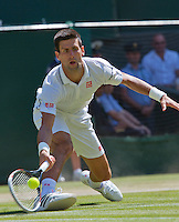 England, London, 28.06.2014. Tennis, Wimbledon, AELTC, Men's semifinal between Novak Djokovic  (SRB) and Grigor Dimitrov (BUL), Pictured: Novak Djokovic<br /> Photo: Tennisimages/Henk Koster