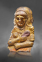Ancient Egyptian Roman female mummy mask, limestone, Roman Period, 2nd Cent AD, Hawara,  Egyptian Museum, Turin. Grey Background<br /> <br /> This is a remarkable gilt cartonnage with inlaid cystal eyes . The woman wears a Roman style hardo half covered by a veil, a himation, fringed cloak, yied to her breat, snake shaped bracelets and a necklace of pink flowers, all of which are connected to the cult of Isis.