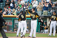 Daniel Robertson (5) and Jett Bandy (27) of the Salt Lake Bees celebrate during the game against the Sacramento River Cats in Pacific Coast League action at Smith's Ballpark on April 20, 2015 in Salt Lake City, Utah.  (Stephen Smith/Four Seam Images)