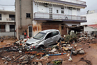 Pictured: A destroyed car and debris sit in the middle of the road.<br />