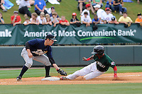 Third baseman Dante Bichette, Jr. (19) of the Charleston RiverDogs puts the tag on Jose Vinicio (36) of the Greenville Drive who was called out trying to steal third base in a game on Sunday, May 19, 2013, at Fluor Field at the West End in Greenville, South Carolina. Charleston won, 9-7. (Tom Priddy/Four Seam Images)