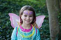 Beautiful little girl dressed up in angel costume, Arts A Glow Festival, Dottie Harper Park, Burien, Washington State, WA, America, USA.
