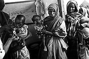 GIZ hospital workers register and measure for malnutritioned children as mothers bring their children to a registration centre in IFO-1camp in the Dadaab refugee camp in northeastern Kenya. Photo: Sanjit Das/Panos