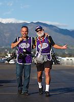Feb 12, 2017; Pomona, CA, USA; NHRA photographers Gary Nastase (left) and Dave Kommel during the Winternationals at Auto Club Raceway at Pomona. Mandatory Credit: Mark J. Rebilas-USA TODAY Sports
