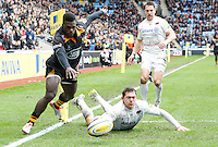 Photo: Richard Lane/Richard Lane Photography. Wasps v Saracens. Aviva Premiership. 08/03/2015. Wasps' Christian Wade goes in for a try as Saracens' Alex Goode attempts to touch down.