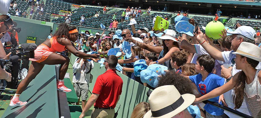 KEY BISCAYNE, FL - APRIL 04: Serena Williams climbs into the crowd to sign autographs after winning the Miami Open for the 8th time after defeating Carla Suarez Navarro of Spain. Serena even took her sneaker off and signed and gave it to one lucky fan on day 13 of the Miami Open at Crandon Park Tennis Center on April 4, 2015 in Key Biscayne, Florida<br /> <br /> <br /> People:  Serena Williams<br /> <br /> Transmission Ref:  FLXX<br /> <br /> Must call if interested<br /> Michael Storms<br /> Storms Media Group Inc.<br /> 305-632-3400 - Cell<br /> 305-513-5783 - Fax<br /> MikeStorm@aol.com