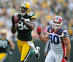 Green Bay Packers tight end Jermichael Finley makes a first down catch in the first quarter ahead of Buffalo Bills' Chris Kelsay during the home opener at Lambeau Field in Green Bay, Wis., on Sunday, Sept. 19, 2010.