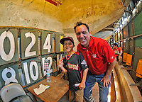 "9 June 2012: Washington Nationals Chief Operating Officer Andrew Feffer and his son pose after signing the wall inside the famed ""Green Monster"" scoreboard wall prior to a game against the Boston Red Sox at Fenway Park in Boston, MA. The Nationals defeated the Red Sox 4-2 in the second game of their 3-game series. Mandatory Credit: Ed Wolfstein Photo"