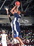 Jackson State Tigerettes forward Kiana McCarty (32) in action during the SWAC Tournament game between the Prairie View A&M Lady Panthers and the Jackson State Tigerettes  at the Special Events Center in Garland, Texas. Prairie View defeats Jackson State 56 to 40.