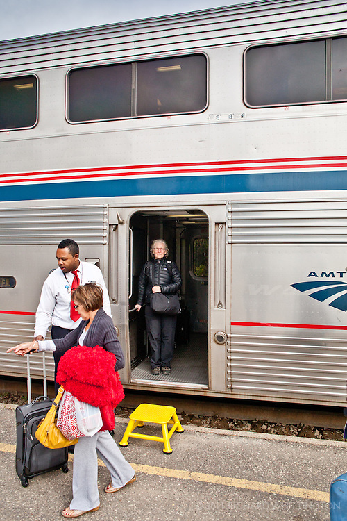 """Carl was our Amtrak Car Attendant (they are NOT called porters as they were when I was a child) on our Minot, North Dakota to Washington leg of the Empire Builder train trip. Carl was our favorite Amtrak employee that we met. He was 6'7"""" as you can see in this picture."""