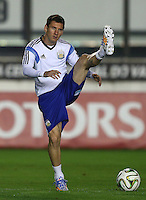 Lionel Messi of Argentina stretches during the training session