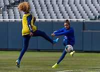 CHICAGO, IL - OCTOBER 5: Casey Short #26 of the United States defends Mallory Pugh #2 at Soldier Field on October 5, 2019 in Chicago, Illinois.