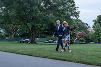 First lady Jill Biden waves to the media as she and United States President Joe Biden walk off of Marine One on the South Lawn of the White House in Washington, DC on Sunday, July 18, 2021. The Bidens spent the weekend at Camp David, the presidential retreat near Thurmont, Maryland.  <br /> CAP/MPI/RS<br /> ©RS/MPI/Capital Pictures