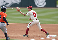 Arkansas infielder Brady Slavens (17) tags out Auburn infielder Rankin Woley (4), Saturday, April 3, 2021 during the first inning of a baseball game at Baum-Walker Stadium in Fayetteville. Check out nwaonline.com/210404Daily/ for today's photo gallery. <br /> (NWA Democrat-Gazette/Charlie Kaijo)