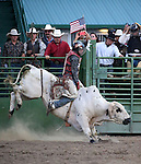 Bull riding action at the Smackdown Tour at Fuji Park in Carson City, Nev., on Saturday, June 7, 2014.<br /> Photo by Cathleen Allison