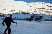 A cross country skier passes the hamlet of lEcot, Bonneval sur Arc, Savoie, France, 17 February 2012.