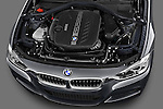 High angle engine detail of a 2013 BMW 330d Touring Wagon