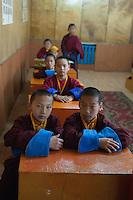 Monks in school at Gesar Sum Monastery