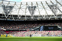 3rd October 2021;   City of London Stadium, London, England; EPL Premier League football, West Ham versus Brentford; The players observe a minutes appreciation for Rodger Hunt who died earlier this week