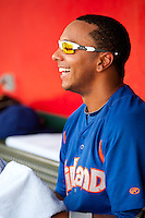 Tyler Ladendorf (5) of the Midland RockHounds laughs in the dugout during a game against the Springfield Cardinals on April 19, 2011 at Hammons Field in Springfield, Missouri.  Photo By David Welker/Four Seam Images