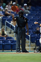 Home plate umpire Matt Blackborow makes a strike call during the game between the Charleston RiverDogs and the Kannapolis Cannon Ballers at Atrium Health Ballpark on June 30, 2021 in Kannapolis, North Carolina. (Brian Westerholt/Four Seam Images)