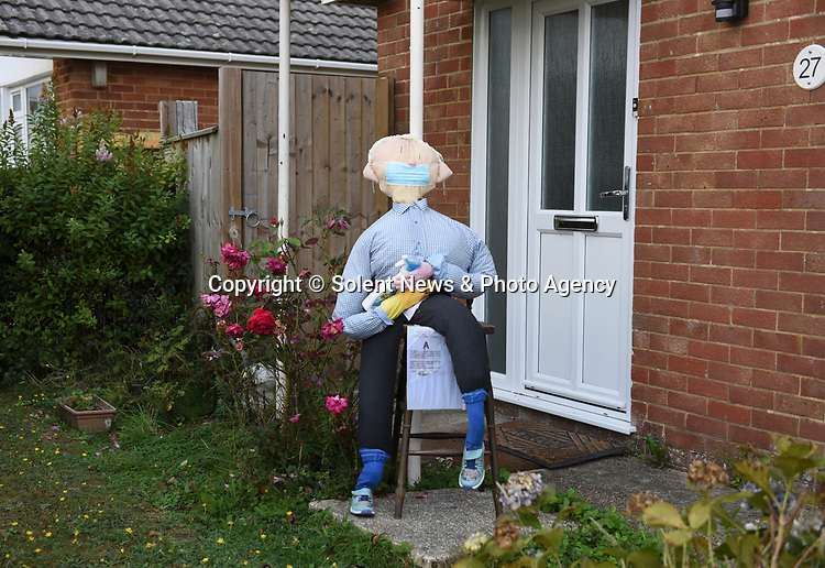 SCARECROW VILLAGE FESTIVAL IN HORDLE, HAMPSHIRE.<br /> <br /> Pictured: Joe Vid - Entry A for the Hordle Scarecrow compeition.<br /> <br /> Entries this year to a village scarecrow competition seem to have taken a Covid-19 theme, with entries showing Dominic Cummings holding a steering wheel next to an eye chart, key workers stood 2 metres apart and politicians stood at lecterns.<br /> <br /> The pandemic appears to have also played a part in the number of entries this year which is down from twenty last year to eight, but families and businesses have still produced a range of scarecrows for the competition.<br /> <br /> The competition this year is raising money for PATCH - Parents and Teachers in the Community of Hordle, and is organised by the Hordle and District Twinning Association.<br /> <br /> © Ewan Galvin/Solent News & Photo Agency<br /> UK +44 (0) 2380 458800