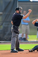 Umpire Mac Dietz makes a call during a game between the GCL Rays and GCL Orioles on July 20, 2013 at Charlotte Sports Complex in Port Charlotte, Florida.  GCL Orioles defeated the GCL Rays 4-1.  (Mike Janes/Four Seam Images)