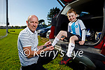 Joe Dillon helping his son Aidan with his boots as he is going training with the Parnells U7 Juvenile Hurlers.